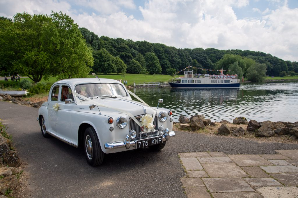 Bridal car with Rutland Belle in background at Normanton Church wedding photography by a Rutland based photographer