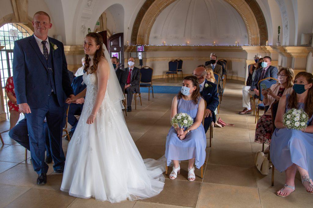 Bride and Groom at Normanton Church Rutland Water by local Rutland photographer