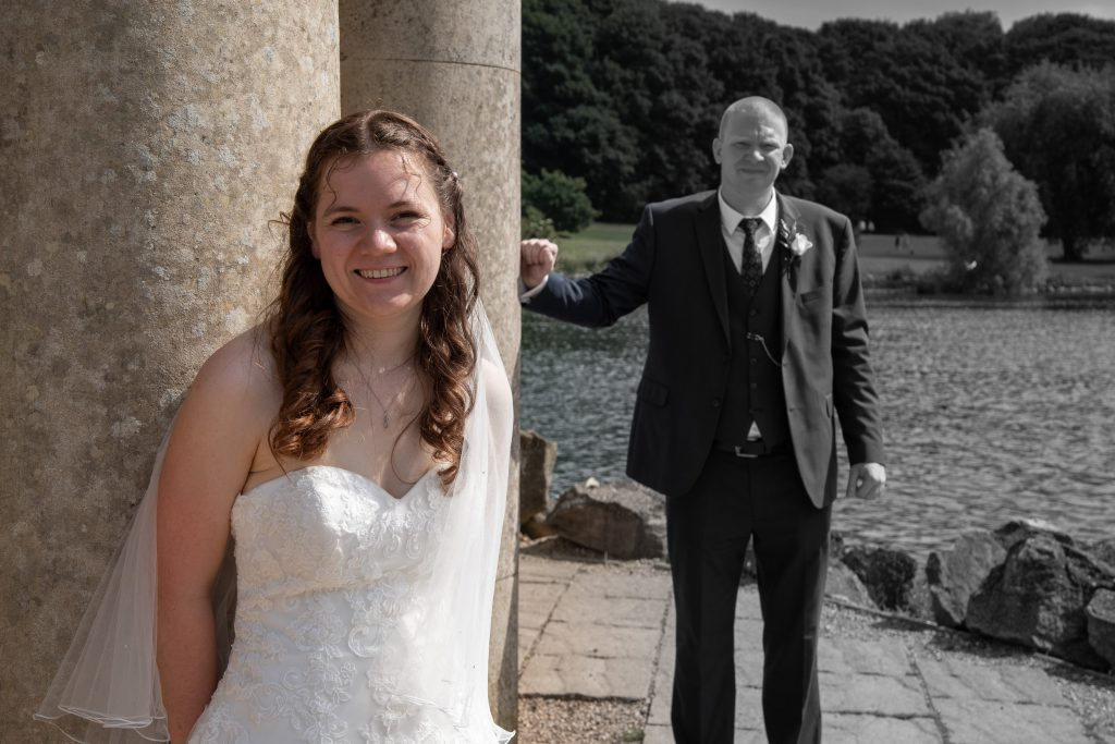 Bride and groom at Normanton Church on Rutland Water by a Rutland based wedding photographer