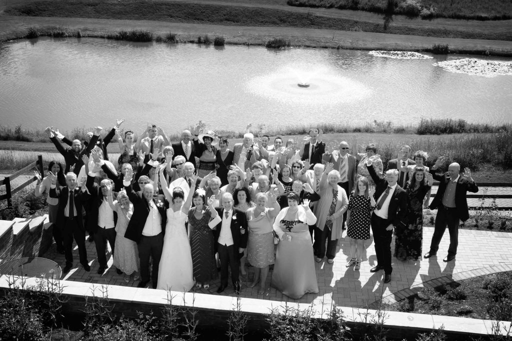 a group photograph at Greetham Valley of a wedding by Rutland based wedding photographer